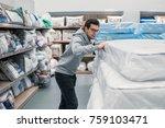 smart customer man chooses bed... | Shutterstock . vector #759103471