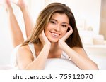 happy beautiful girl resting on ... | Shutterstock . vector #75912070