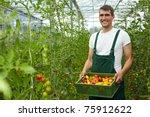 happy organic farmer carrying...   Shutterstock . vector #75912622