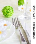 Spring table setting with flowers and decoration - stock photo