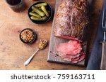 roast beef on cutting board.... | Shutterstock . vector #759163711