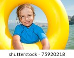 Happy summer vacation -  girl playing in the sea - stock photo