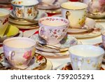 porcelain tea cups on a table | Shutterstock . vector #759205291