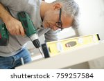 man assembling diy furniture... | Shutterstock . vector #759257584