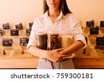 young woman holding glass jars... | Shutterstock . vector #759300181