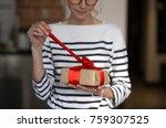 female hands holding gift box... | Shutterstock . vector #759307525
