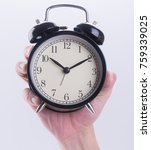 Small photo of alarm clock or alarm clock with hand on the background