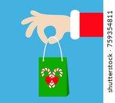 santa claus hand holding gift... | Shutterstock .eps vector #759354811