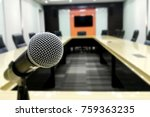Small photo of Microphone and modern table boardroom with chair / meeting associate concept.