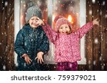 on christmas night an adorable... | Shutterstock . vector #759379021