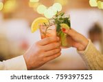 two cocktail glasses in man and ... | Shutterstock . vector #759397525