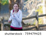 woman running in wooded forest... | Shutterstock . vector #759479425