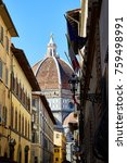 Small photo of View of the Cathedral of Santa Maria del Fiore with one of the adjacent streets. Florence, Italy