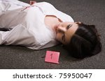 Crime scene. Dead nurse lying on the floor - stock photo