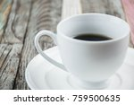 cup of coffee on a wooden table | Shutterstock . vector #759500635