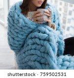 girl wrapped in a blue blanket... | Shutterstock . vector #759502531