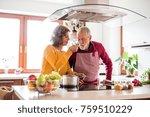 senior couple preparing food in ... | Shutterstock . vector #759510229