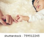 mom and baby hands promise.... | Shutterstock . vector #759512245