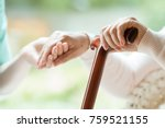 elder person using wooden... | Shutterstock . vector #759521155