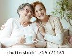 smiling nurse in beige uniform... | Shutterstock . vector #759521161