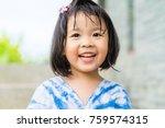 Happy Little Asian Girl Having...