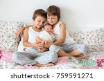 two children  toddler and his... | Shutterstock . vector #759591271