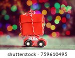 miniature red car carrying a... | Shutterstock . vector #759610495