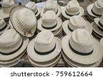 pile of straw hats | Shutterstock . vector #759612664
