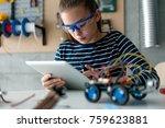 typing on digital tablet | Shutterstock . vector #759623881