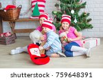 happy kids near xmas tree with...   Shutterstock . vector #759648391