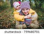 the younger sister hugs her... | Shutterstock . vector #759680701