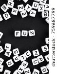 Small photo of Fun word made of beads. a series of minimalism phrases and words.