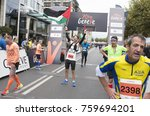 Small photo of GENEVA, SWITZERLAND – OCTOBER 29, 2017: Mohammad Alqadi from Palestine celebrates completing the inaugural edition of the Geneva 20km race in 280 place.