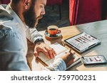 young businessman is sitting at ... | Shutterstock . vector #759700231