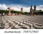 Manaus city sidewalk with Amazon theatre and church