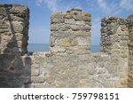 Stone Wall Overlooking The Sea