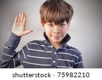 child with raised hand making a ... | Shutterstock . vector #75982210