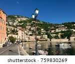Small photo of Idyllic view of colorful Villefrance-sur-mere bay in Nice, with restaurants in southern France on a sunny day