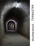 Small photo of old abandoned railway tunnel with different lighting effects and moods, alter Eisenbahntunnel mit unterschiedlichen Lichteffekten, antiguo túnel ferroviario con diferentes efectos luminosos