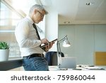businessman in office connected ... | Shutterstock . vector #759860044