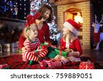 family with kids at christmas... | Shutterstock . vector #759889051