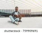cheerful young black student is ... | Shutterstock . vector #759909691
