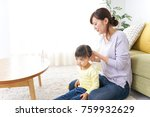 mother tieing child's hair... | Shutterstock . vector #759932629