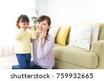 mother tieing child's hair... | Shutterstock . vector #759932665