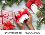 female hands holding christmas... | Shutterstock . vector #760002409