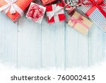 christmas gift boxes on wooden... | Shutterstock . vector #760002415