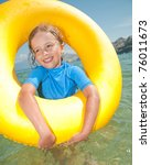 Happy summer vacation - little girl playing in water - stock photo