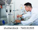young man in white coat working ... | Shutterstock . vector #760131505