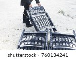 a woman moving plastic chairs... | Shutterstock . vector #760134241