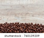 coffee beans on wood background | Shutterstock . vector #760139209